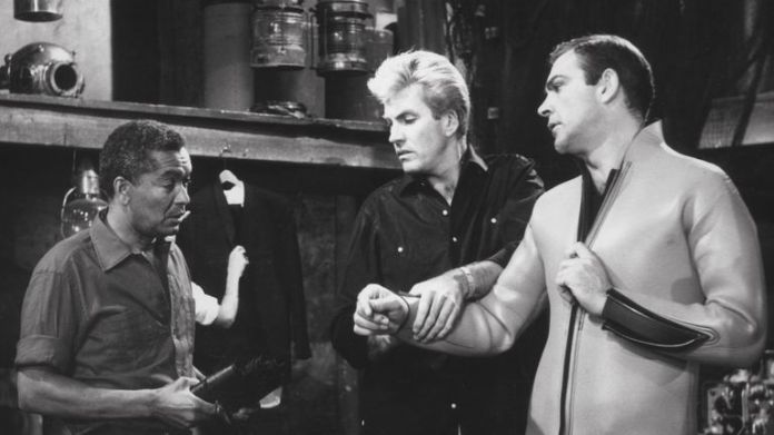 Earl Cameron (L) in a scene from the 1965 Bond film Thunderball with Rick Van Nutter (C) and Sean Connery (R)