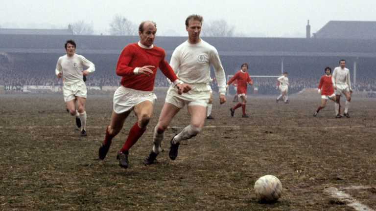 The Charlton brothers - Bobby (L) and Jack - in action for their rival clubs Manchester United and Leeds United in January 1969