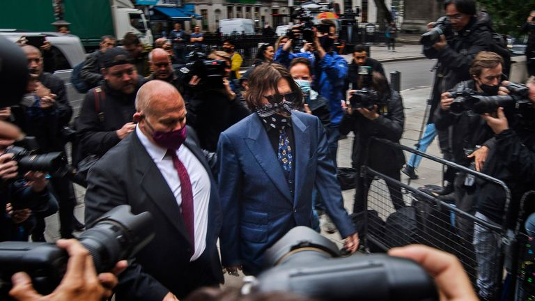 """Actor Johnny Depp arriving at the High Court in London for a hearing in his libel case against the publishers of The Sun and its executive editor, Dan Wootton. PA Photo. Picture date: Thursday July 9, 2020. 57-year-old Depp is suing the tabloid's publisher News Group Newspapers (NGN) over an article which called him a """"wife beater"""" and referred to """"overwhelming evidence"""" he attacked Ms Heard, 34, during their relationship, which he strenuously denies. See PA story COURTS Depp. Photo credit should read: Victoria Jones/PA Wire"""