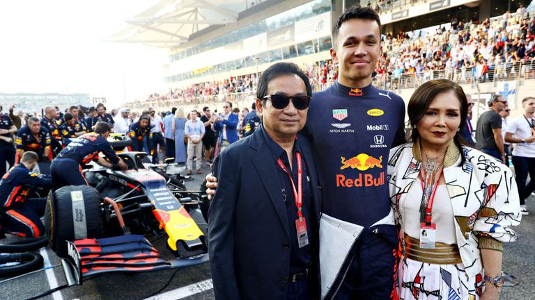 Worayuth's father, Chalerm Yoovidhya (L) inherited the Red Bull business from his father