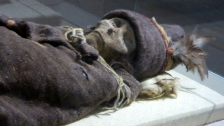 A 3,800-year-old mummified body found on the edge of the Tarim basin in Xinjiang, which is said to have European and other features