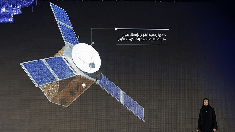Sarah Amiri, deputy project manager of the United Arab Emirates (UAE) Mars Mission, stands on stage during a ceremony to unveil the mission on May 6, 2015 in Dubai. The UAE Mars Mission aims to provide a global picture of the Martian atmosphere through a probe named Al Amal to be launched in July 2020 to reach Mars in 2021, according to the engineers involved in the project. AFP PHOTO / KARIM SAHIB (Photo credit should read KARIM SAHIB/AFP via Getty Images)