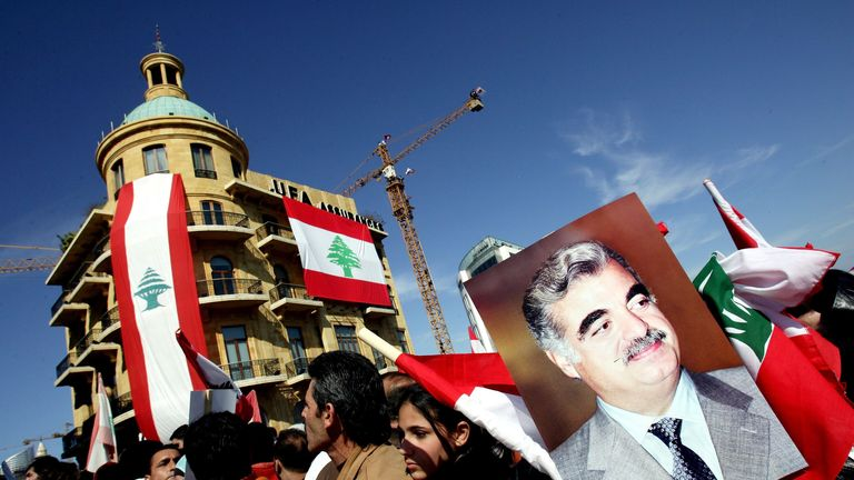 BEIRUT, LEBANON - FEBRUARY 14:  Hundreds of thousands of Lebanese turn out to mourn the one year anniversary of the assassination of former Lebanese Prime Minister Rafiq Hariri, displayed on a placard, February 14, 2006 in Beirut, Lebanon. Hariri's murder is widely blamed on Syrian elements. Outrage of the assassination led to massive demonstrations in the streets of Beirut a year ago that forced the Syrian regime to pull its forces out of the country after 29 years occupation.  (Photo by Ghaith Abdul-Ahad/Getty Images)