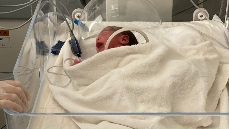 Seconds after the baby is born a swab is taken and her vital signs are recorded