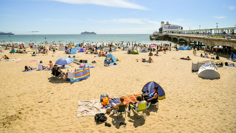 People flocked to a beach in Bournemouth on Saturday to enjoy the hot weather.