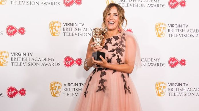 Caroline Flack with the BAFTA For Best Reality & Factual Built In the press room during the Virgin TV British Academy Television Awards at the Royal Festival Hall on May 13, 2018 in London
