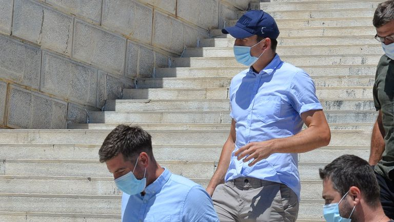 Manchester United captain Harry Maguire leaves a court building on the island of Syros, Greece