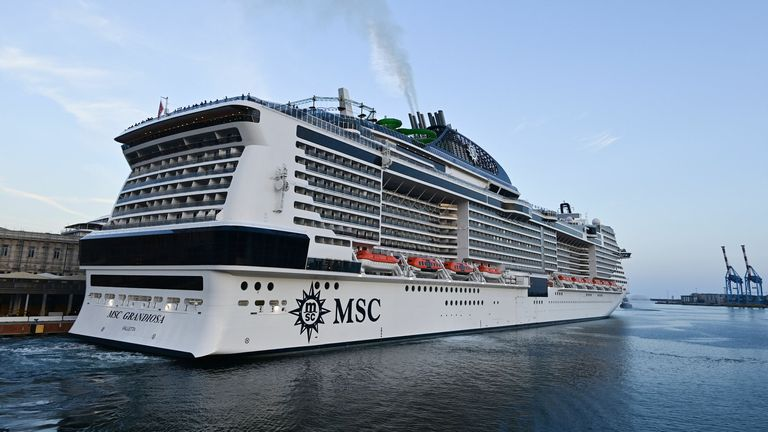 A picture taken in the northern Italian port of Genoa on August 16, 2020 shows the MSC Grandiosa cruise liner leaving port after six-and-half months of inactivity due to the novel coronavirus, COVID-19, pandemic. - The first major cruise ship to set sail in the Mediterranean was poised to depart from Genoa as Italy's struggling travel industry hopes to regain ground after a bruising coronavirus hiatus, representing a high-stakes test for the global sector in the key Mediterranean market and beyo