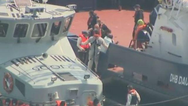 Migrants are brought ashore in Dover