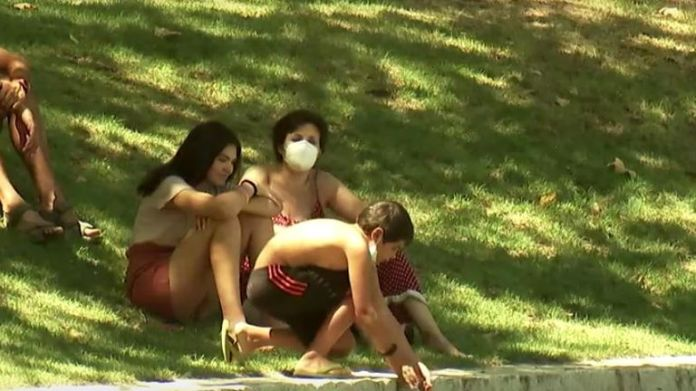 Families cool off with water as Madrid experienced hot weather last week