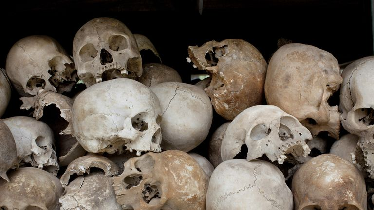 "PHNOM PENH, CAMBODIA-JULY 26 : Some of the 8,000 human skulls sit in a glass case at the Choeung Ek Genocidal Center where July 26, 2010 in Phnom Penh province. Today the UN -backed Khmer Rouge tribunal convicted Kaing Guek Eav, also known as ""Duch"", to 35 years in prison. He was the prison chief and has acknowledged responsibility for overseeing the torture and execution of more than 15,000 people at the notorious S-21 prison known as Tuol Sleng. Kaing Guek Eay, 67 will serve only 19 years of the sentence since he already spent 11 years awaiting the trial in detention.  (Photo by Paula Bronstein/ Getty Images)"