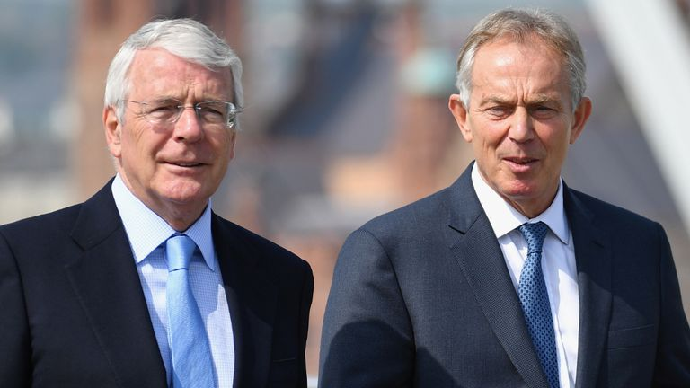 Former prime ministers Sir John Major (left) and Tony Blair walk across the Peace Bridge in Londonderry following a Remain campaign event at the University of Ulster in Londonderry.