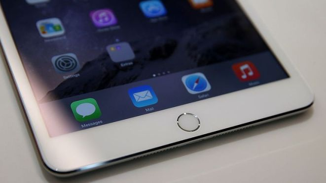 CUPERTINO, CA - OCTOBER 16: A touch I.D. pad is seen on the new iPad Mini 3 during an Apple special event on October 16, 2014 in Cupertino, California. Apple unveiled the new iPad Air 2 and iPad Mini 3 tablets and the iMac with 5K retina display. (Photo by Justin Sullivan/Getty Images)