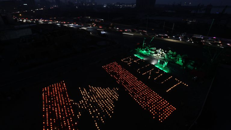 Paper lanterns in the shape of a Lebanese flag mark one month since the city's deadly explosion