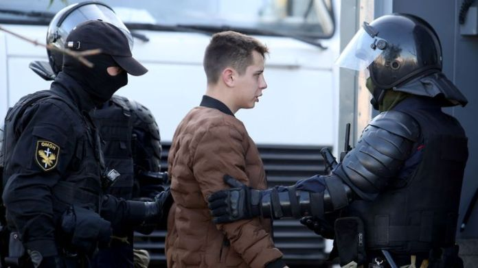 A man is arrested by police on September 20, 2020 in Minsk on the sidelines of a demonstration called by the opposition movement for the end of the regime of authoritarian leader Alexander Lukashenko. - Belarusian authorities brought military trucks and barbed wire into central Minsk today ahead of a planned opposition march, a day after police arrested hundreds of demonstrators. (Photo by - / TUT.BY / AFP) (Photo by - / TUT.BY / AFP via Getty Images)