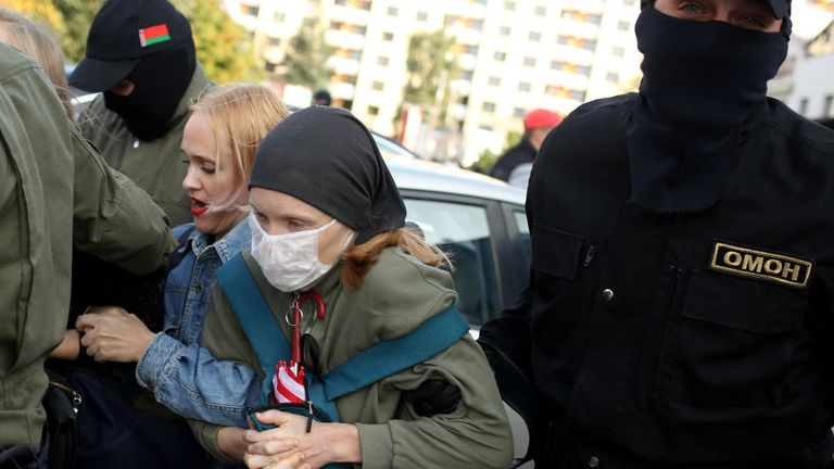 Law enforcement officers detain women during a rally to protest against the Belarus presidential election results in Minsk on September 19, 2020. - Belarus President Alexander Lukashenko, who has ruled the ex-Soviet state for 26 years, claimed to have defeated opposition leader Svetlana Tikhanovskaya with 80 percent of the vote in the August 9, elections. (Photo by - / TUT.BY / AFP) (Photo by -/TUT.BY/AFP via Getty Images)