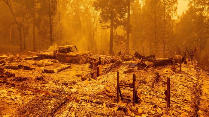 The remains of a smoldering house in Butte County, California