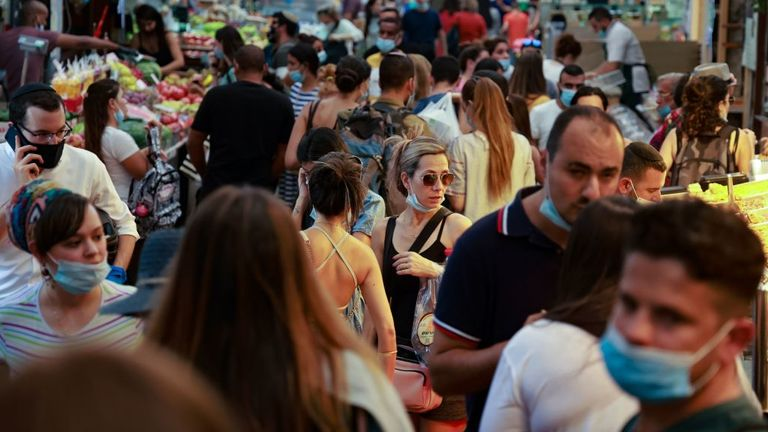 Shoppers are seen at a market in Jerusalem is coronavirus cases soared