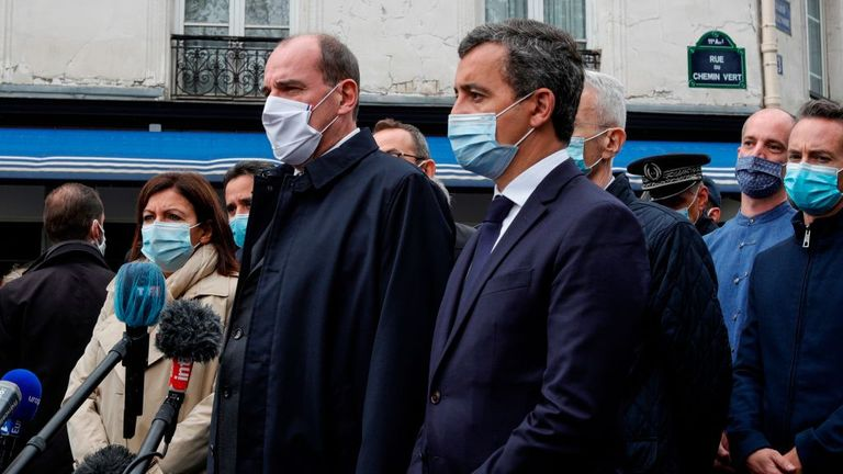 French Prime Minister Jean Castex (centre) speaks to journalists with the French Interior Minister Gerald Darmanin (right) and Paris mayor Anne Hidalgo (left)