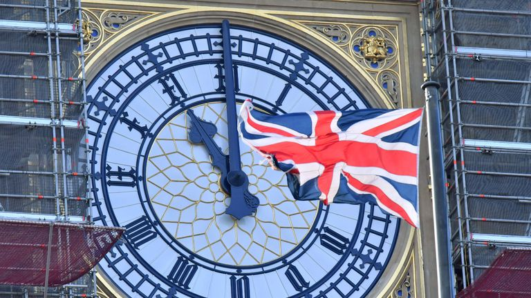 TOPSHOT - The clock face of Elizabeth Tower, known after the bell Big Ben, shows the hands at eleven o'clock as a Union Flag flies in front of it in London on January 28, 2020. - Britain will formally leave the European Union at 11pm GMT on January 31, 2020. (Photo by Justin TALLIS / AFP) (Photo by JUSTIN TALLIS/AFP via Getty Images)