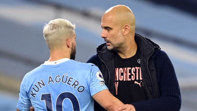 Manchester City's Argentinian striker Sergio Aguero (L) is substituted by Manchester City's Spanish manager Pep Guardiola during the English Premier League football match between Manchester City and Arsenal at the Etihad Stadium in Manchester, north west England, on October 17, 2020. (Photo by Michael Regan / POOL / AFP) / RESTRICTED TO EDITORIAL USE. No use with unauthorized audio, video, data, fixture lists, club/league logos or 'live' services. Online in-match use limited to 120 images. An ad