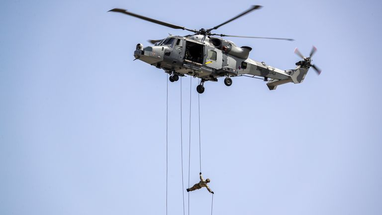 Some of the SBS fast-roped from a Merlin - a technique shown here by a Royal Marine in Gibraltar. Pic: Royal Navy/Barry Swainsbury