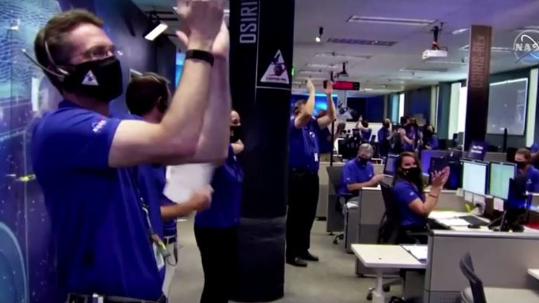 Cheers erupted in Denver when the Osiris-Rex confirmed it had carried out the mission. Pic: NASA