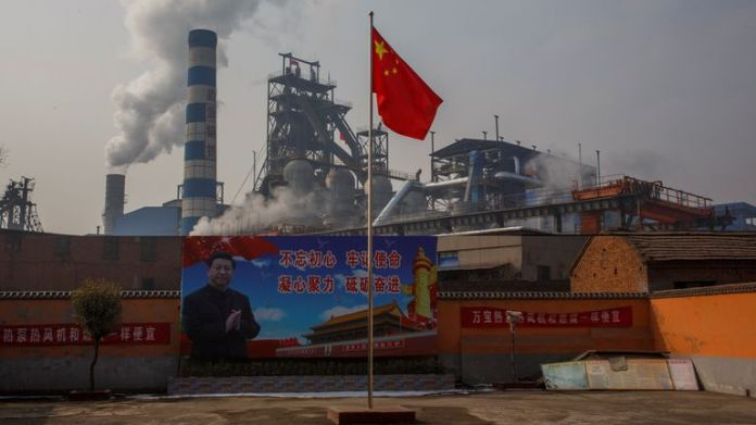 Chinese President Xi Jinping is pictured on a billboard outside a steel plant in Henan