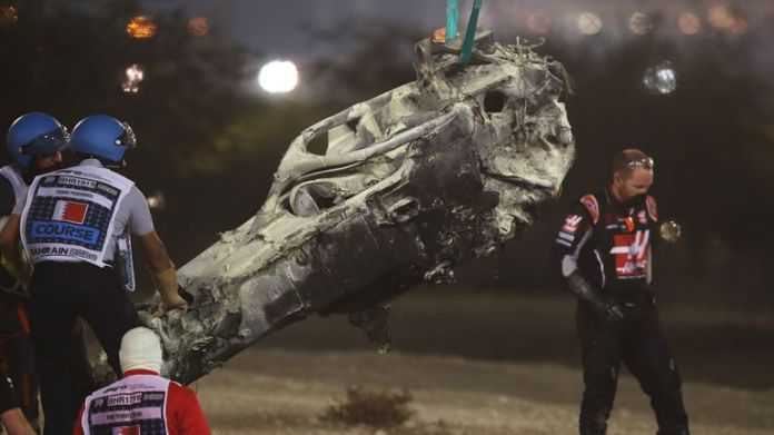 The wreckage of the car of French driver Romain Grosjean of Haas F1 is removed during the Bahrain Formula 1 Grand Prix at the Bahrain International Circuit in the city of Sakhir on November 29, 2020 (Photo by HAMAD I MOHAMMED / POOL) / AFP) (Photo by HAMAD I MOHAMMED / POOL / AFP via Getty Images)