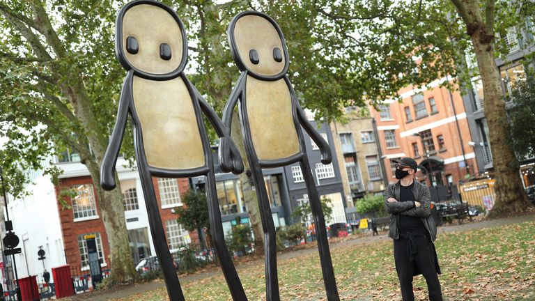 Stik with his bronze sculpture of Holding Hands in Hoxton Square