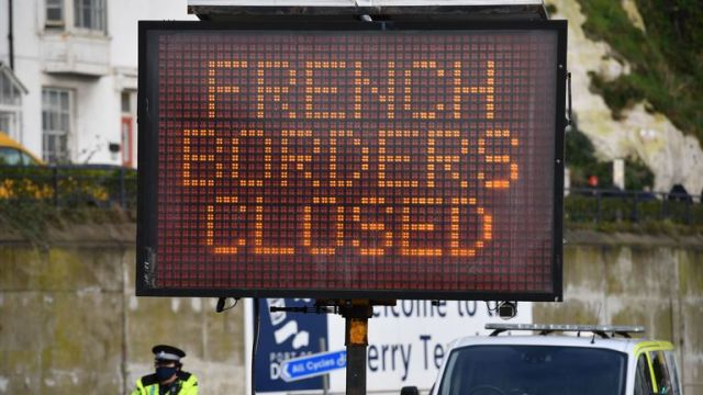 A sign informs drivers that the French border crossing is closed at the cordoned entrance to the ferry terminal at the Port of Dover in Kent, south east England on December 22, 2020, after France closed its borders to accompanied freight arriving from the UK due to the rapid spread of a new coronavirus strain. - Britain sought to sound a note of calm saying they were working as fast as possible to unblock trade across the Channel after France shut its borders to UK hauliers in a bid to contain a new variant of the coronavirus. (Photo by JUSTIN TALLIS / AFP) (Photo by JUSTIN TALLIS/AFP via Getty Images)