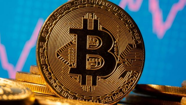 A representation of virtual currency Bitcoin is seen in front of a stock graph in this illustration taken November 19, 2020