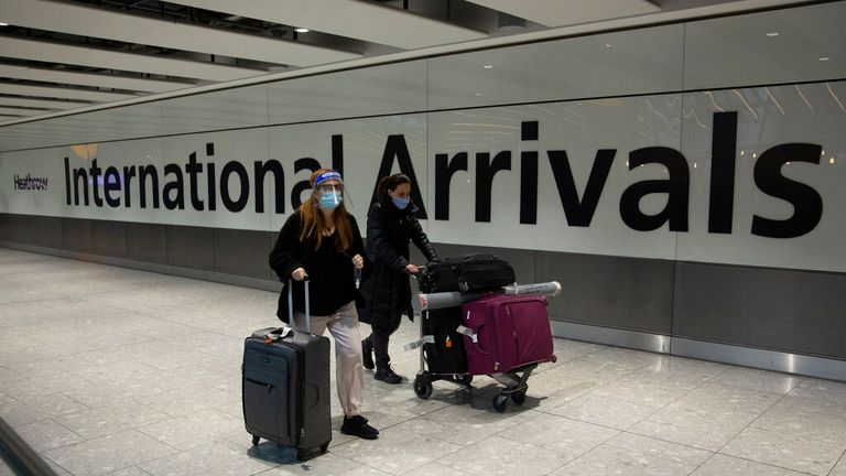 Passengers arrive in the arrivals area at Heathrow Airport, in London, Monday, Jan. 18, 2021. The UK closed all travel corridors from Monday morning to protect against the coronavirus with travellers entering the country from overseas required to have proof of a negative COVID-19 test. (AP Photo/Matt Dunham).
