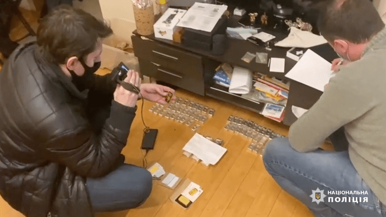 Police officers record a gold shipment that the cybercriminals have hidden. Image: National Police of Ukraine