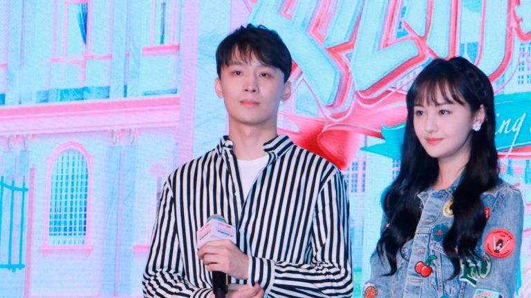 """Chinese actress Zheng Shuang, right, and her boyfriend Zhang Heng attend a press conference for reality show """"Meeting Mr. Right"""" Season 2 in Shanghai, China, 22 August 2019. (Imaginechina via AP Images)"""
