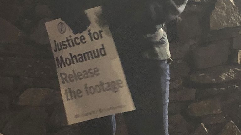 A 'justice for Mohamud Hassan' sign at a vigil in Cardiff