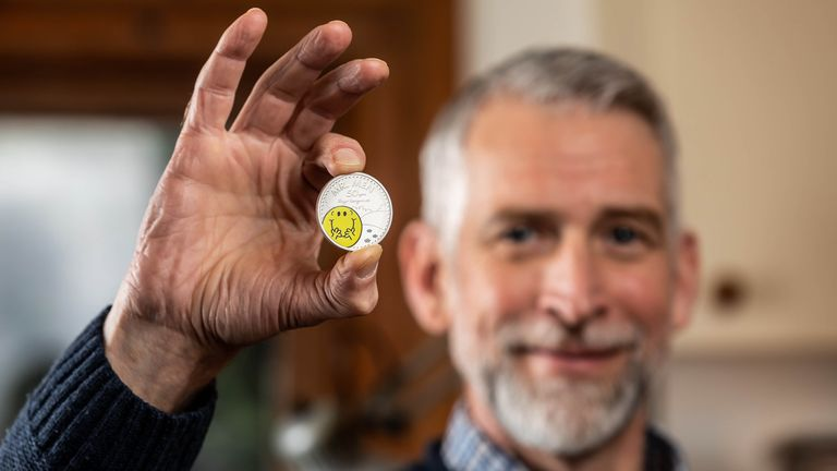 Adam Hargreaves, son of Mr Men and Little Miss creator Roger Hargreaves, holds The Royal Mint's new £5 Mr Happy coin, which launches today to celebrate 50 years of the characters