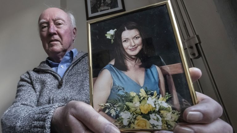 Peter Lawrence holds a photo of his daughter Claudia