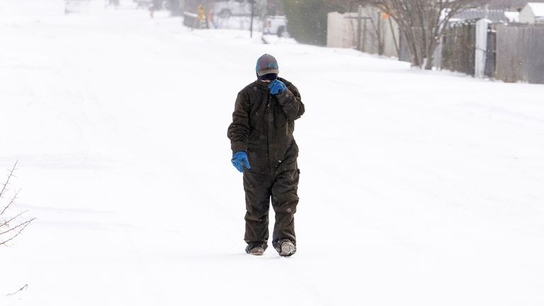 A woman braves the snow in Oklahoma City