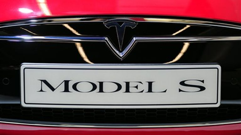 ARCHIVE - The logo of the automobile manufacturer Tesla, taken on September 10, 2013 during the press day at the International Motor Show (IAA) in Frankfurt (Hesse) and a