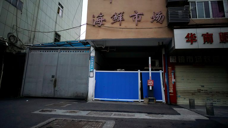 A blocked entrance to huanan seafood market, where COVID-19 is believed to have first surfaced