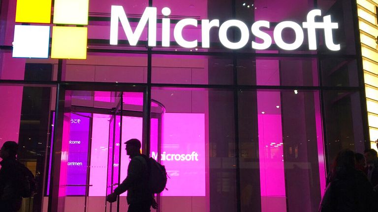 In this November 10, 2016 photo, people walk near a Microsoft New York office. Microsoft Corp. published on Thursday, January 26, 2017, quarterly results. (AP Photo / Swayne B. Hall)