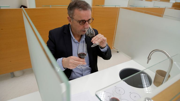 In a one-of-a-kind tasting, 12 connoisseurs tasted one of the wines that traveled to space.  Pic: AP