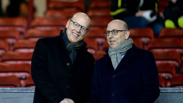 File photo dated 11-02-2015 of Manchester United co-chairs Joel Glazer (right) and Avram Glazer (left).  Issue date: Monday April 19, 2021.