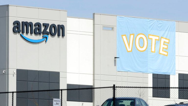 A banner encouraging workers to vote in labor balloting is shown at an Amazon warehouse in Bessemer, Ala., on Tuesday, March 30, 2021. Organizers are pushing for some 6,000 Amazon workers to join the Retail, Wholesale and Department Store Union on the promise it will lead to better working conditions, better pay and more respect. Amazon is pushing back, arguing that it already offers more than twice the minimum wage in Alabama and workers get such benefits as health care, vision and dental insur