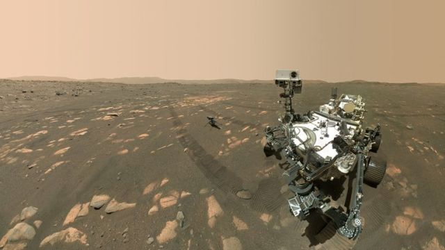 NASA's Perseverance Mars rover took a selfie with the Ingenuity helicopter, seen here about 13 feet (3.9 meters) from the rover. This image was taken by the WATSON camera on the rover's robotic arm on April 6, 2021, the 46th Martian day, or sol, of the mission.
