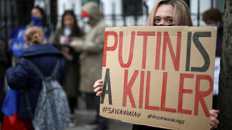 A woman holds a sign during a demonstration in support of  Alexei Navalny in London