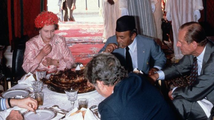 Prince Philip and the Queen eating lamb in Morocco. Pic: Anwar Hussein