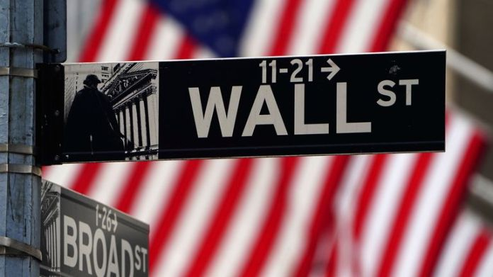 A Wall Street sign is pictured outside the New York Stock Exchange amid the coronavirus disease (COVID-19) pandemic in the Manhattan borough of New York City, New York, U.S., April 16, 2021.