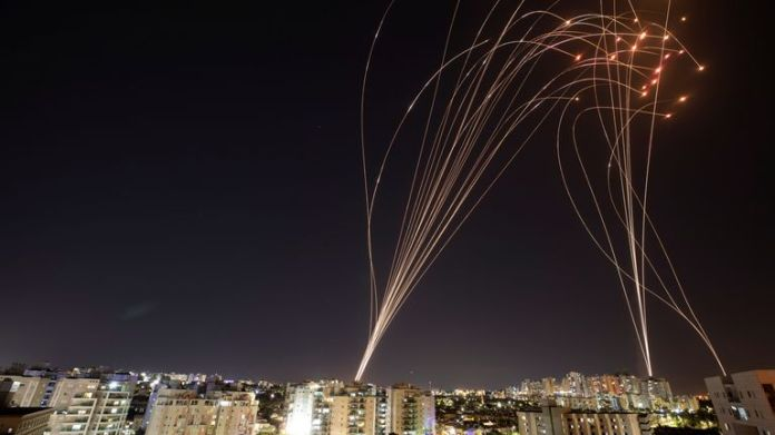 Trails of light are seen in Ashkelon as Israel's Iron Dome missile system intercepts rockets launched from Gaza into Israel